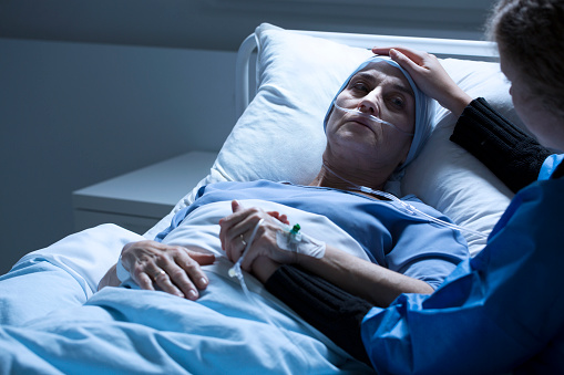 istock Volunteer supporting dying woman 939771318