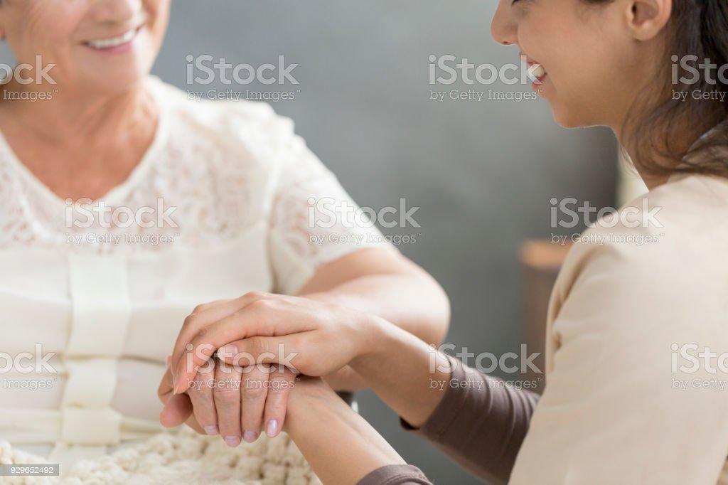 Volunteer taking care of senior stock photo