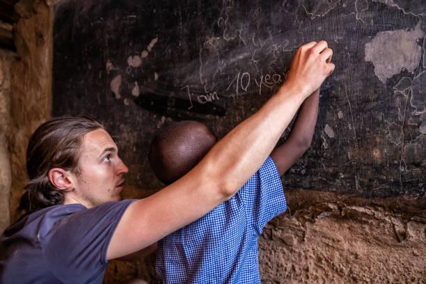 Volunteer Teaching in Africa, orphanage in Kenya stock photo