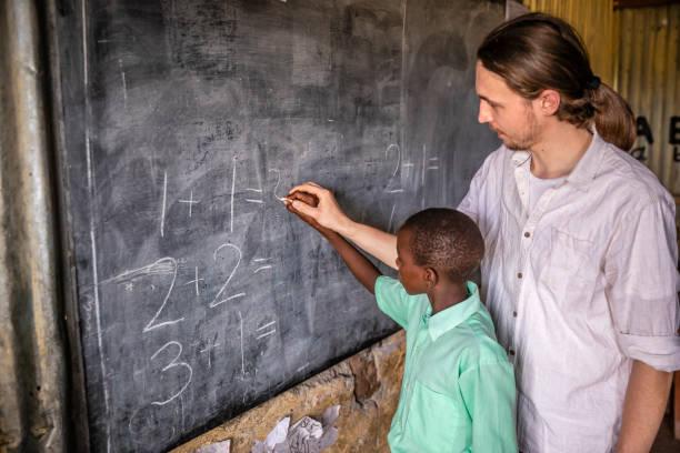 Volunteer Teaching in Africa, school near Masai Mara Game Reserve in Kenya stock photo
