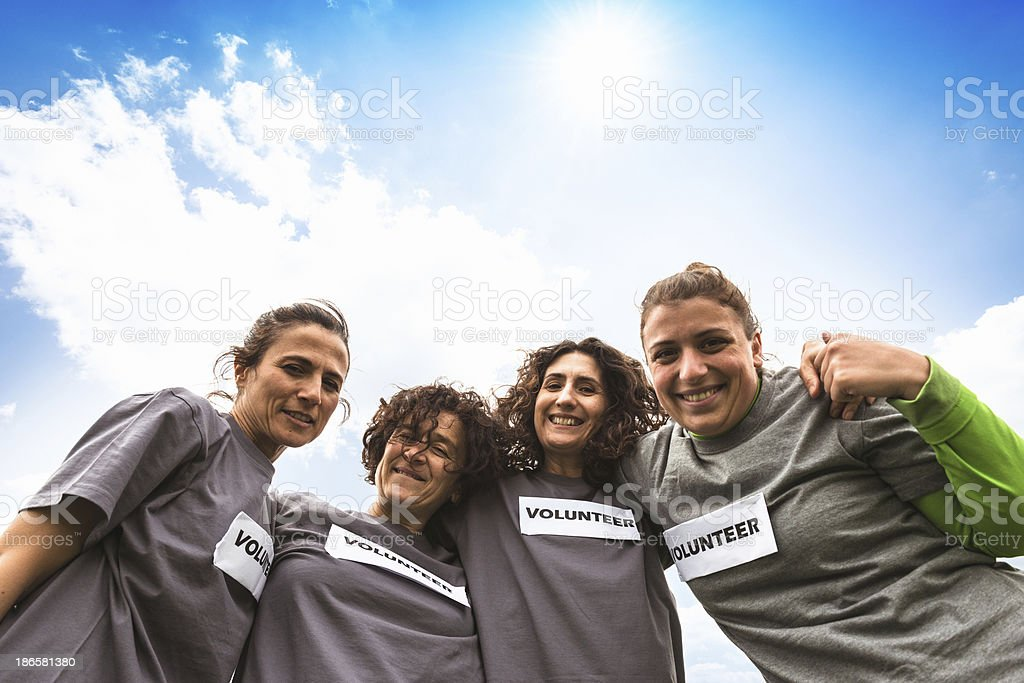 Volunteer togetherness embracing royalty-free stock photo