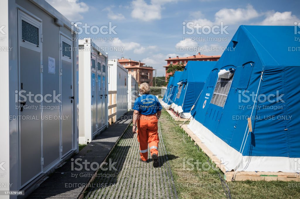 Volunteer walking at Refugee Camp after Italian Eartquake of 2012 stock photo