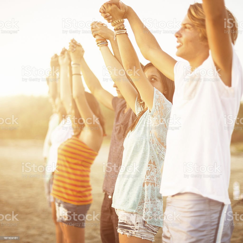volunteer with arm raised at sunset royalty-free stock photo
