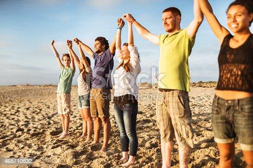 istock volunteer with arm raised at sunset 465710532