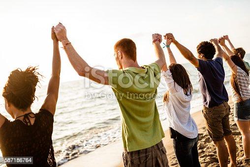 847516586 istock photo volunteer with arm raised at sunset 587186764