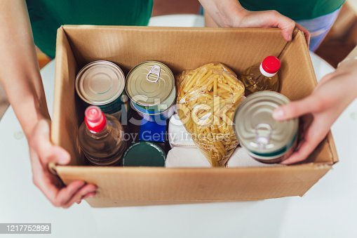 istock Volunteer with box of food for poor. Donation concept. 1217752899