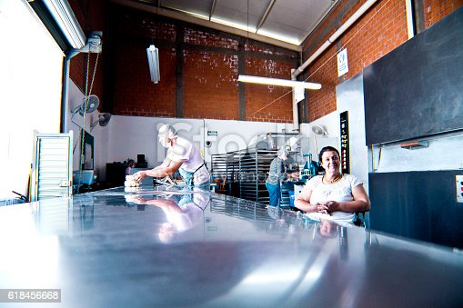 594475880istockphoto Volunteer with disability working at Bakery Workshop 618456668