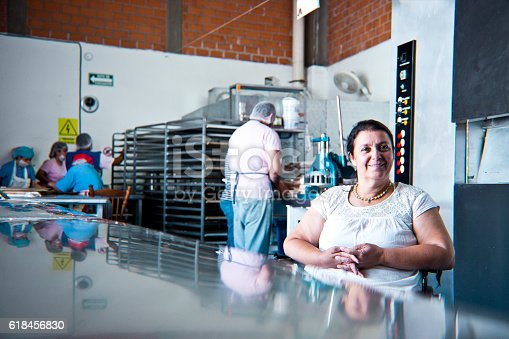 594475880istockphoto Volunteer with disability working at Bakery Workshop 618456830