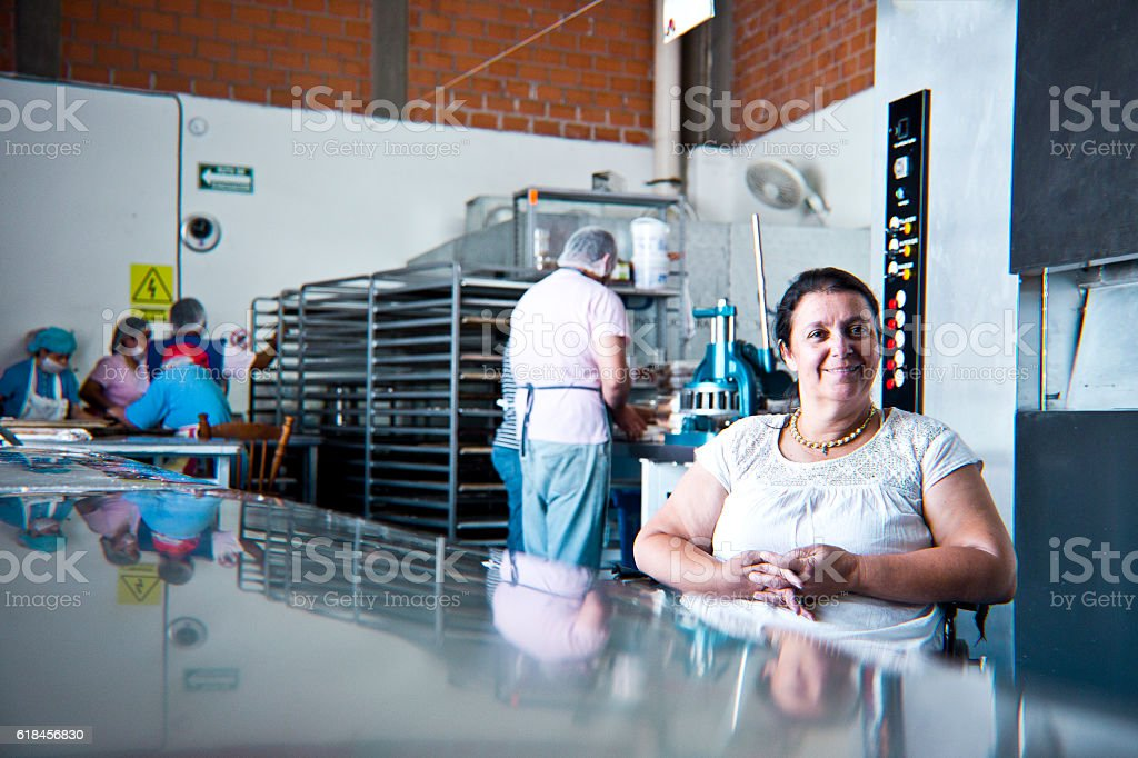 Volunteer with disability working at Bakery Workshop stock photo