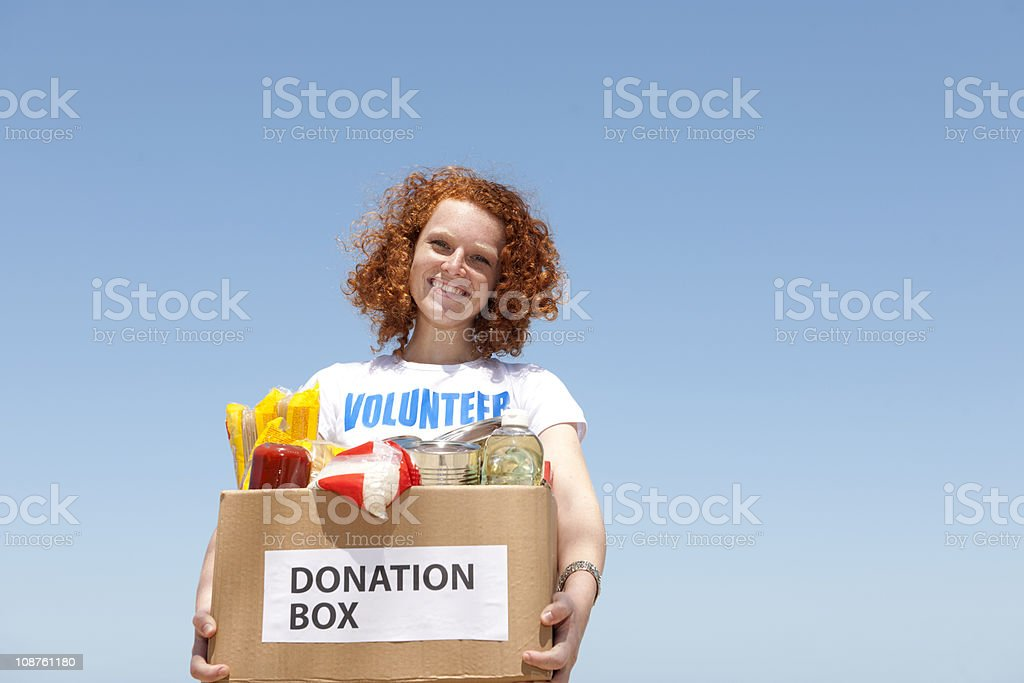 volunteer with donation box stock photo