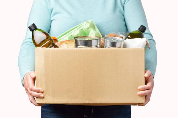 volunteer with donation box - cassetta per le offerte foto e immagini stock