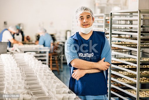 594475880istockphoto Volunteer with intelectual disability working at Bakery Workshop 594475536