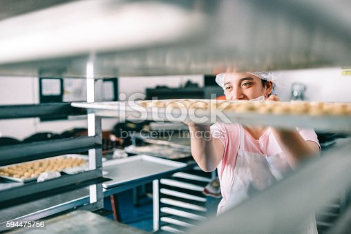 594475880istockphoto Volunteer with intelectual disability working at Bakery Workshop 594475756