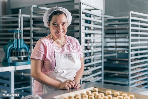 istock Volunteer with intelectual disability working at Bakery Workshop 594475880