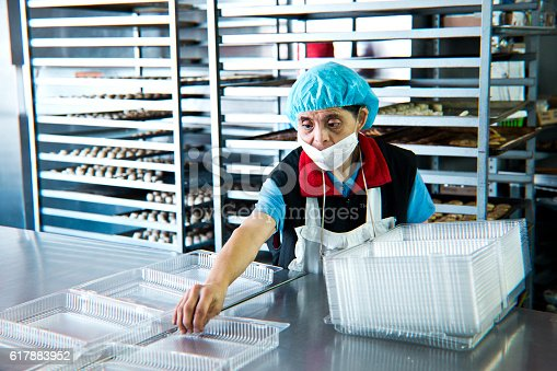 594475880istockphoto Volunteer with intelectual disability working at Bakery Workshop 617883952