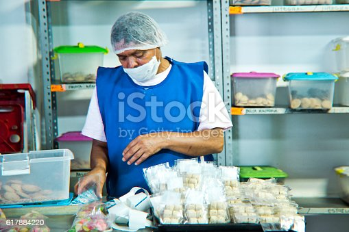 594475880istockphoto Volunteer with intelectual disability working at Bakery Workshop 617884220