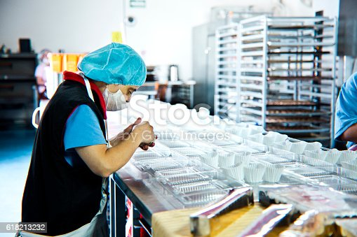 594475880istockphoto Volunteer with intelectual disability working at Bakery Workshop 618213232