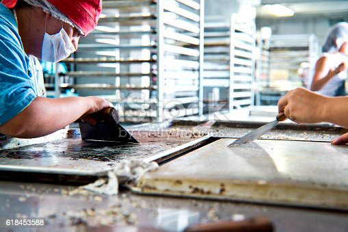 594475880istockphoto Volunteer with intelectual disability working at Bakery Workshop 618453588