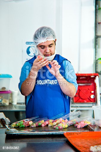 594475880istockphoto Volunteer with intelectual disability working at Bakery Workshop 618454382