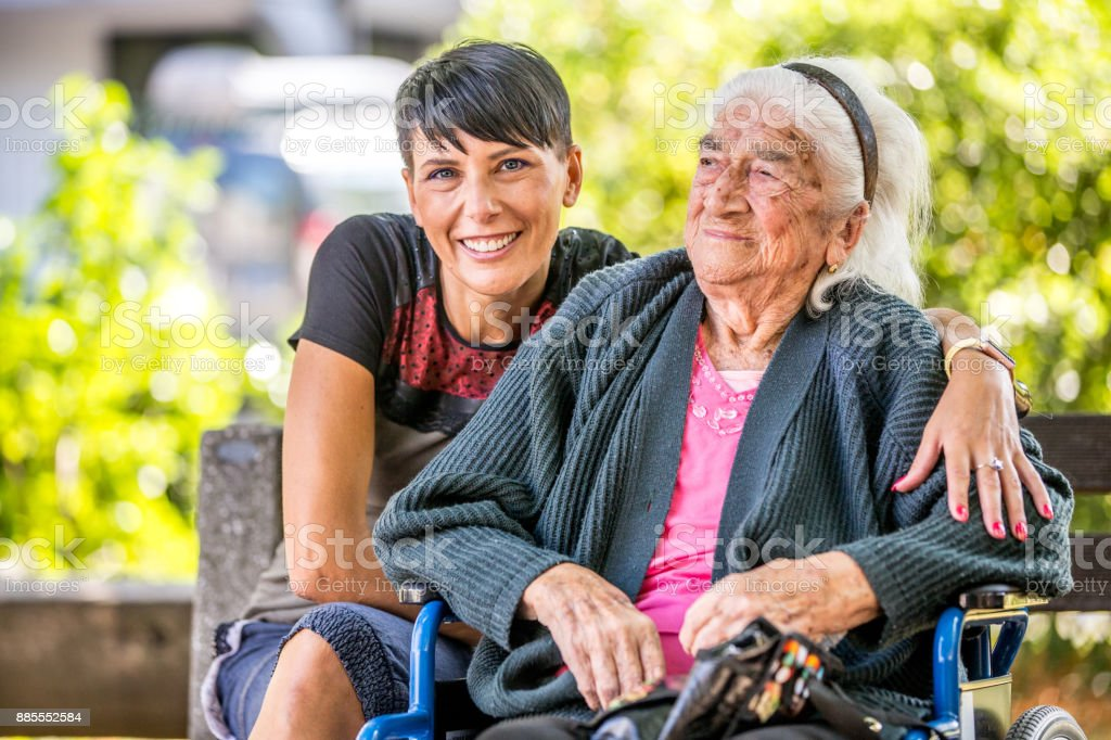 Volunteer Woman Visiting Senior Woman In The Nursing Home