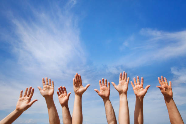 volunteering concept, hands of group of people - volunteer stock photos and pictures