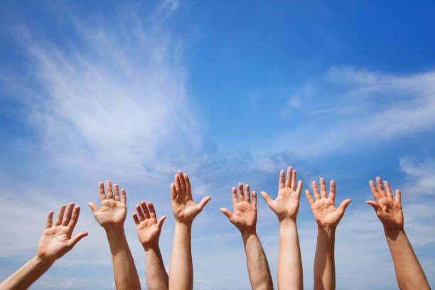 volunteering concept, hands of group of people - voting hands stockfoto's en -beelden