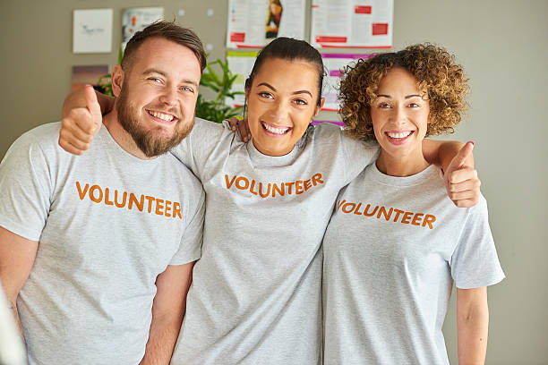 volunteering team stock photo