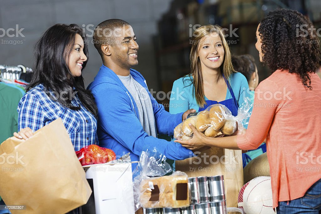 Volunteers accepting grocery donations at community food bank stock photo