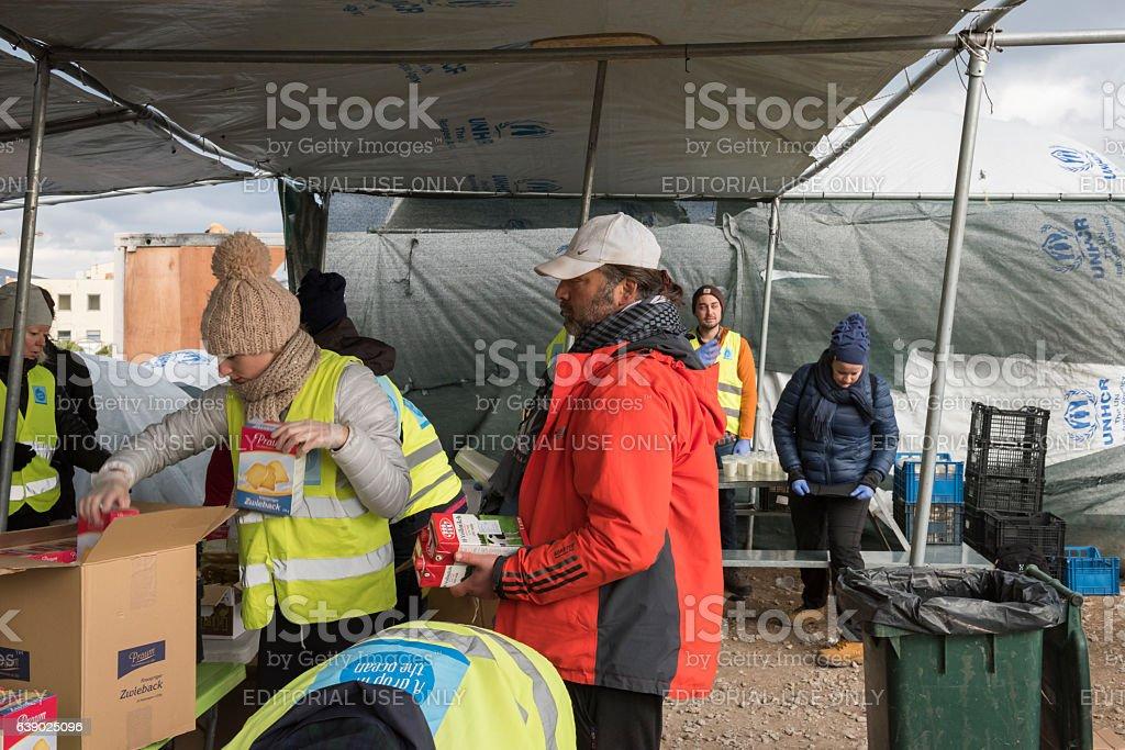Volunteers are distributing breakfast in Greek refugee camp at Christmas stock photo