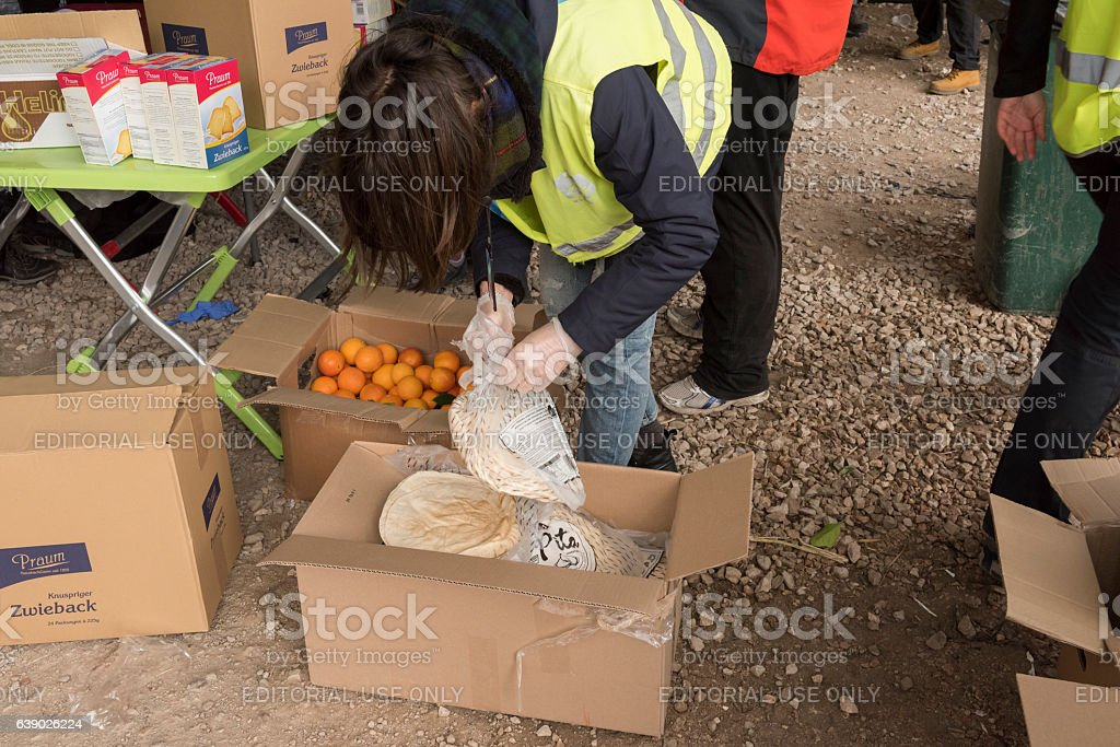 Volunteers are distributing breakfast in Greek refugee camp at Christmas stock photo