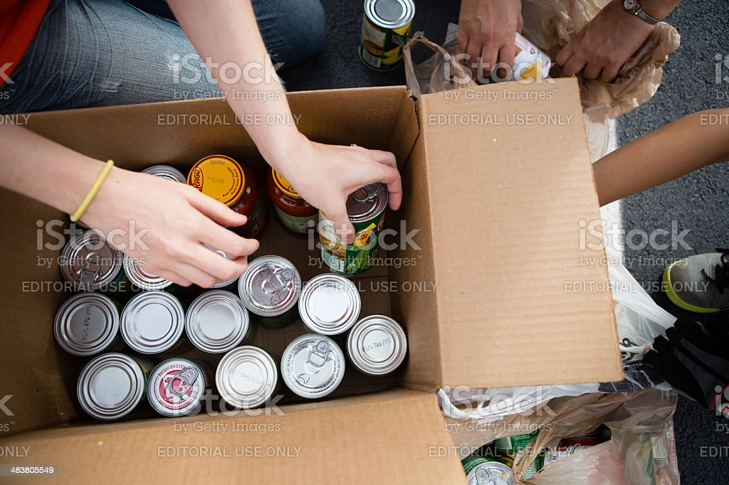 Volunteers Boxing Cans at Food Drive royalty-free stock photo