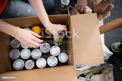 istock Volunteers Boxing Cans at Food Drive 483805549