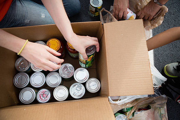 Volunteers Boxing Cans at Food Drive stock photo