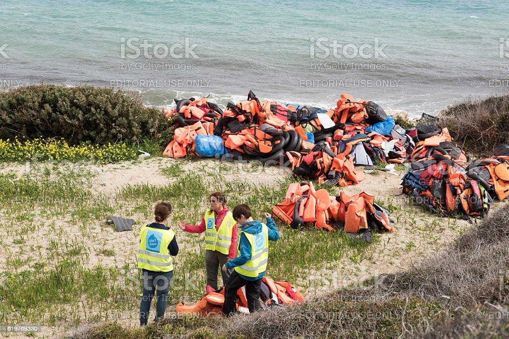 Volunteers cleaning Greek Island beach after refugee landings royalty-free stock photo
