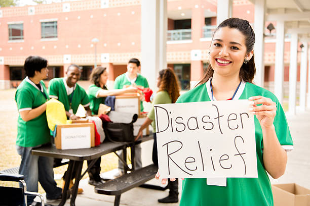 Volunteers: College students collect clothing donations for disaster relief. stock photo