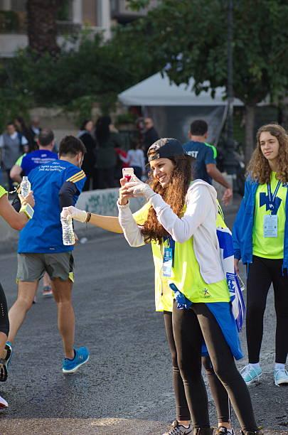 Volunteers during The 33rd Athens Classic Marathon stock photo