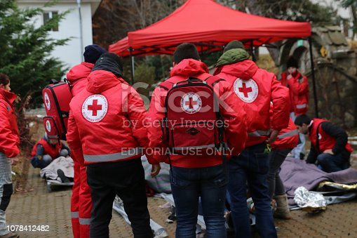 Sofia, Bulgaria - December 5, 2018: Volunteers from the organization of the Bulgarian Red Cross participate in training with a fire service. They help provide first aid to people after an earthquake and fireSofia, Bulgaria - December 5, 2018: Volunteers from the organization of the Bulgarian Red Cross participate in training with a fire service. They help provide first aid to people after an earthquake and fire