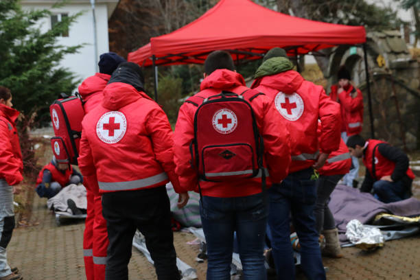 Volunteers from the organization of the Bulgarian Red Cross participate in training with a fire service. They help provide first aid to people after an earthquake and fire Sofia, Bulgaria - December 5, 2018: Volunteers from the organization of the Bulgarian Red Cross participate in training with a fire service. They help provide first aid to people after an earthquake and fireSofia, Bulgaria - December 5, 2018: Volunteers from the organization of the Bulgarian Red Cross participate in training with a fire service. They help provide first aid to people after an earthquake and fire emergency sign stock pictures, royalty-free photos & images