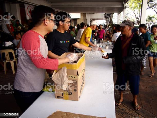 Volunteers give out food during a feeding program at a church picture id1000863084?b=1&k=6&m=1000863084&s=612x612&h=5qorecrx8dwjardnq4f4tqs2ahsodk1 gssfl61chde=