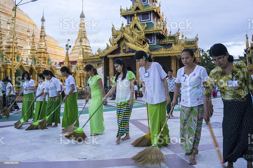 Volunteers in Shwedagon Pagoda, Yangon, Myanmar royalty-free stock photo