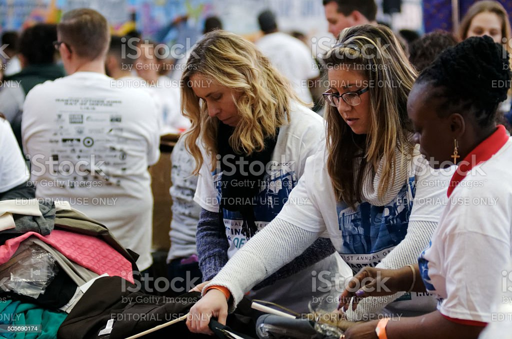 Volunteers Sort Business Attire for MLK Day of Service stock photo