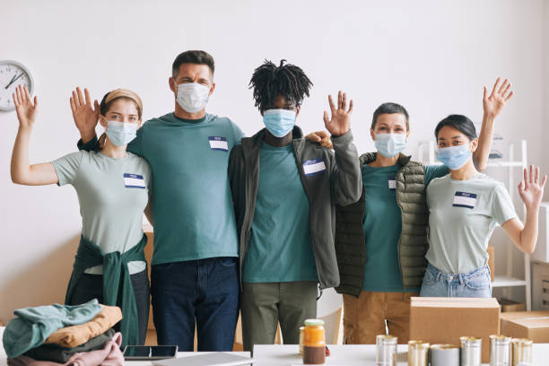 Volunteers Wearing Masks stock photo