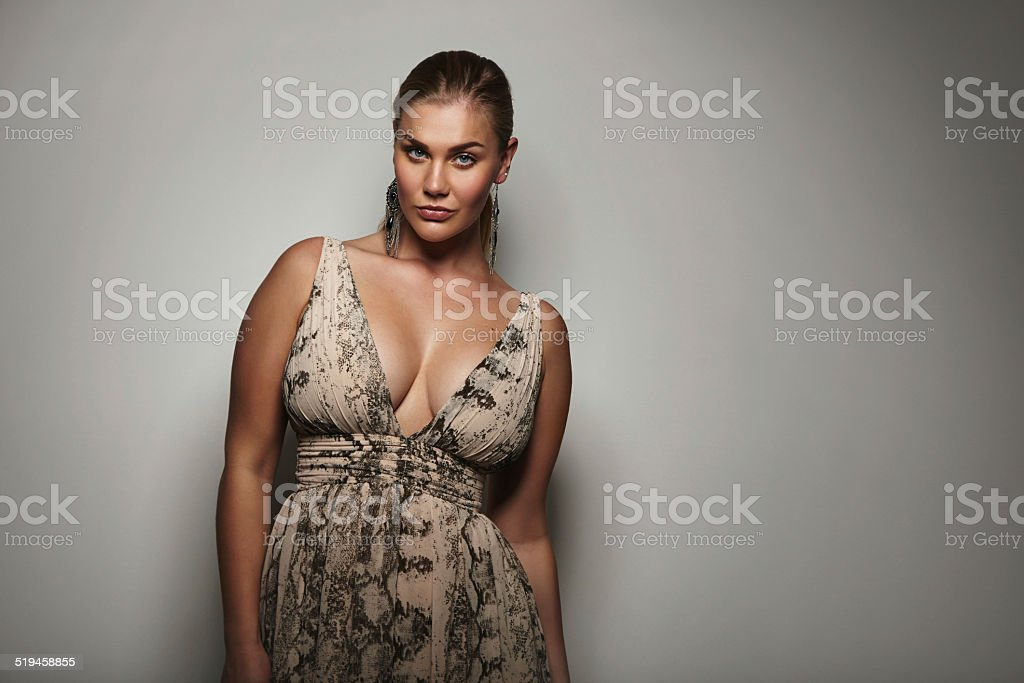 Voluptuous female model posing a beautiful dress stock photo