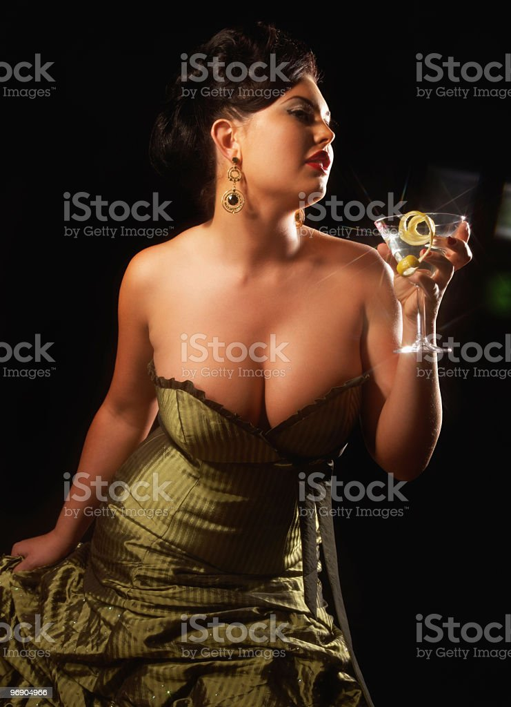Voluptuous Woman Wearing Strapless Gown and Holding Martini royalty-free stock photo