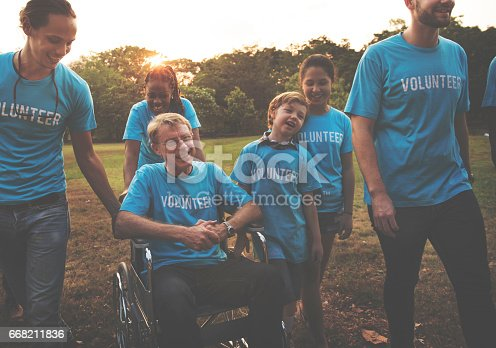 istock Voluteer group of people for charity donation in the park 668211836
