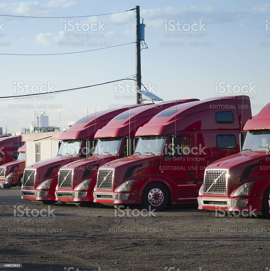 Volvo red big truck in row stock photo