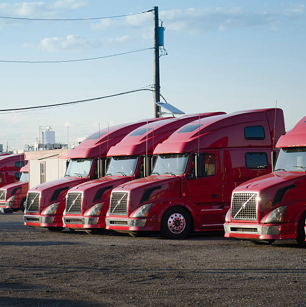 volvo red big truck in row - volvo trucks bildbanksfoton och bilder