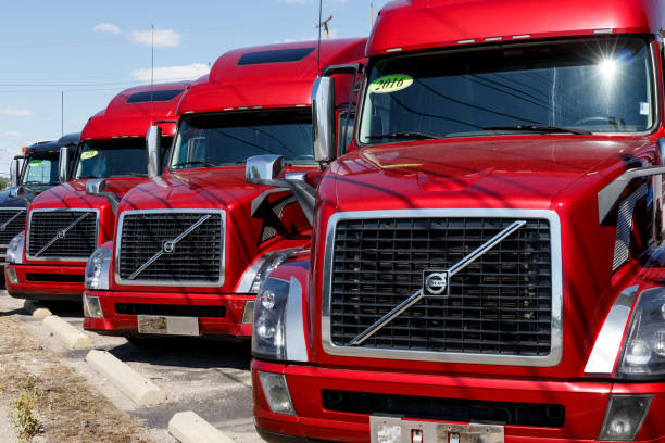 Volvo Semi Tractor Trailer Trucks Lined up for Sale. Volvo is one of the largest truck manufacturers VI stock photo