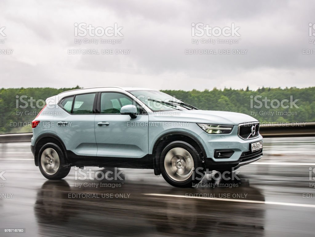 Volvo XC40 Minsk, Belarus - June 15, 2018: Volvo XC40 drives on a highway during rainy summer day. Volvo XC40 is the first subcompact SUV made by Volvo. Under the bonnet of this T5 AWD model is a 2.0-litre turbo-petrol engine with a substantial 250bhp. Belarus Stock Photo