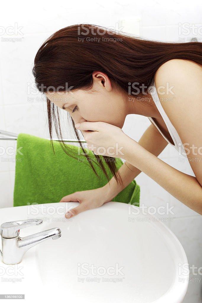 Vomiting woman stock photo